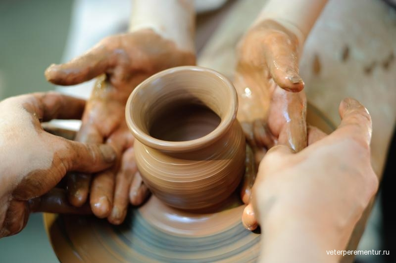 potter-making-a-jug-out-of-clay-on-a-pottery-wheel