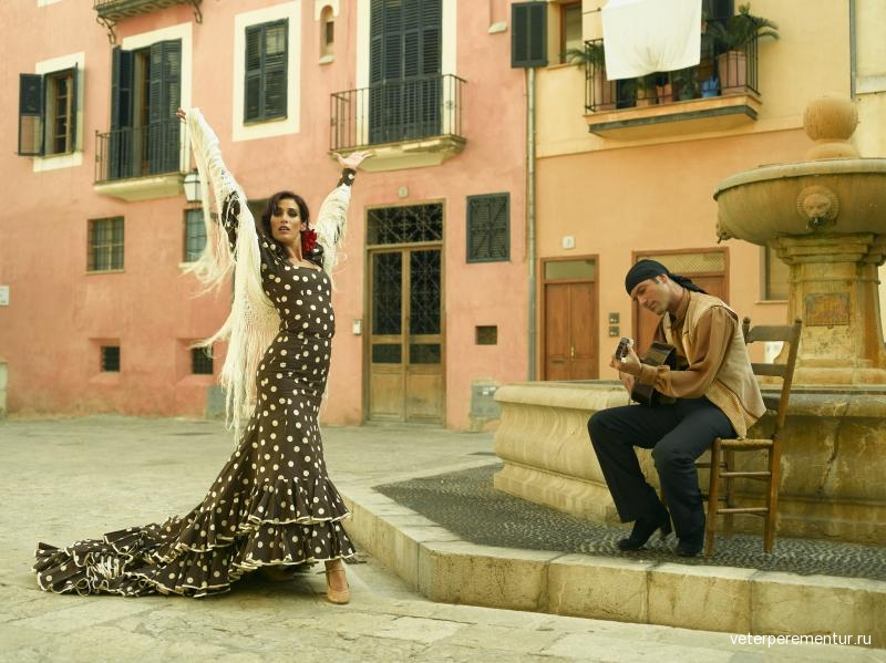 young-woman-dancing-flamenco-and-a-mid-adult-man-playing-the-guitar